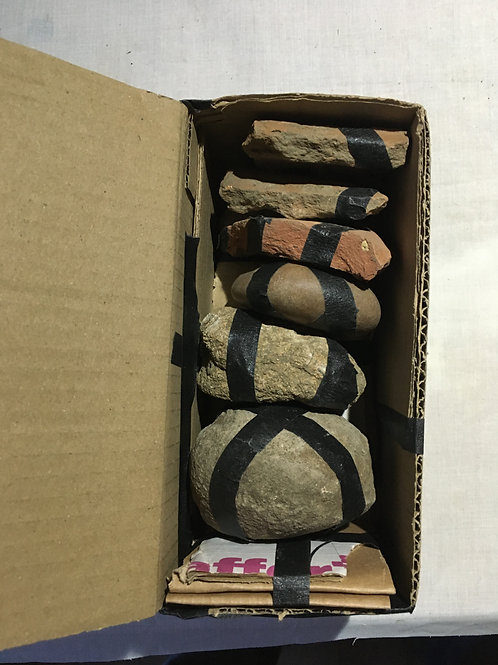 Black Tape, Stones, Pottery in Cardboard Box