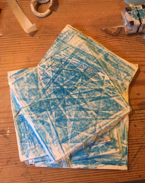Plastic squares wrapped in masking tape and rubbed with crayon.