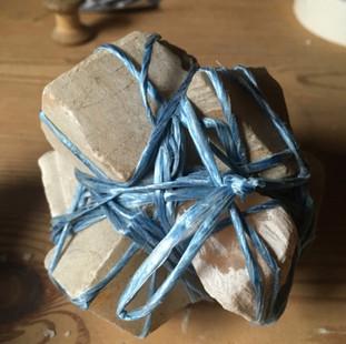 Alabaster offcuts bound in string