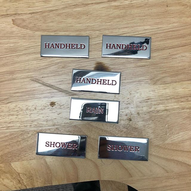 Polished stainless nameplates for shower