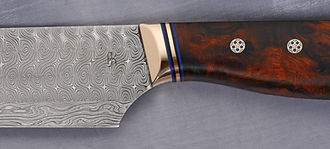 Damastkochmesser Exklusiv Kochmesser Wüsteneisenholz geschmiedet detailfoto Zwinge Griff