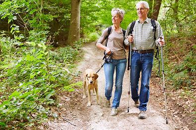 elder-couple-hiking-dog.jpeg