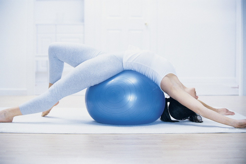 Woman Stretching on Balance Ball