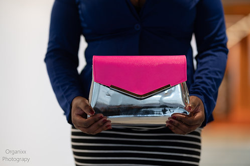 Neon pink and silver curvy clutch