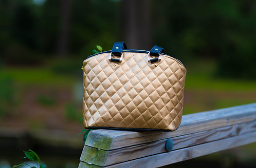 Gold and black quilted shoulder bag