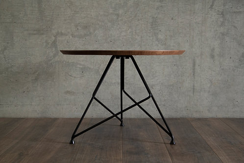 Round walnut coffee table by Massimo Cappella