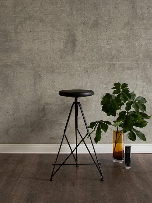 Black tinted hard wood bar stool by Massimo Cappella