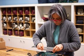 Seamstress in shop