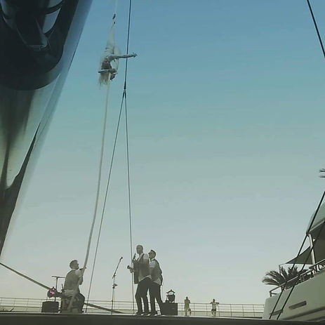 Aerial rope performance in Monaco with Radio Band