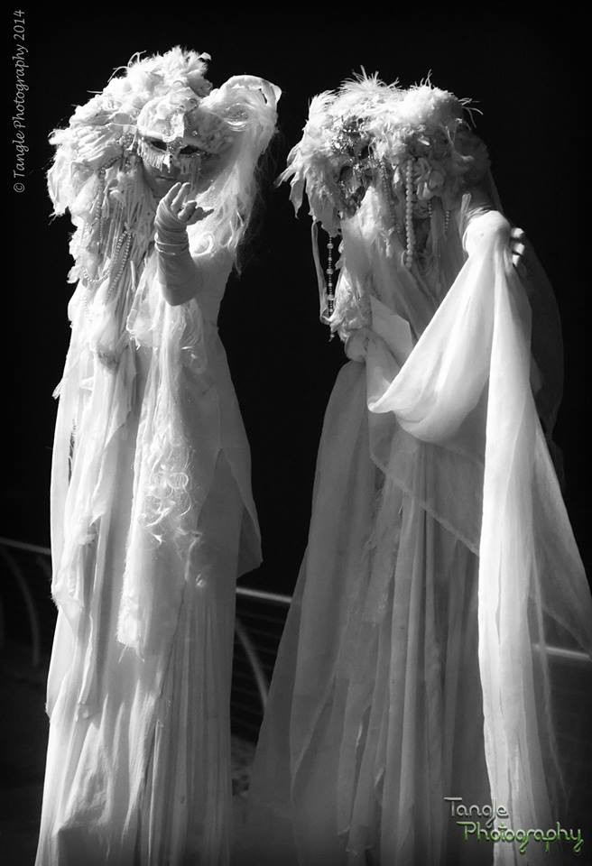 Ghost stilt walkers by Tangle Photography