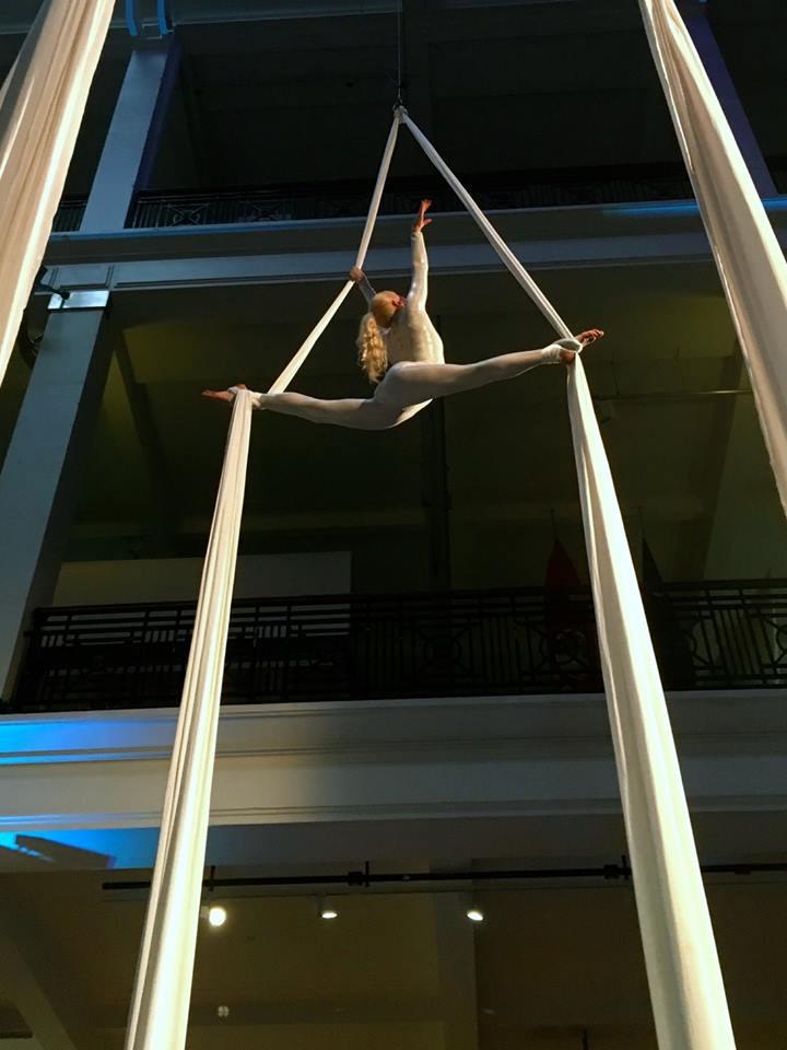 Splits on aerial silks in the Science Museum London