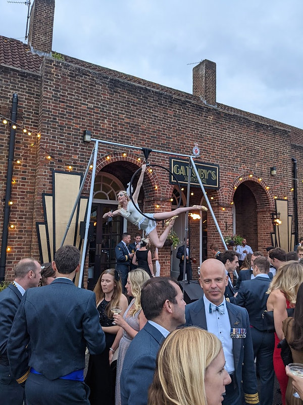 Gatsby party aerial bar tending on freestanding rig