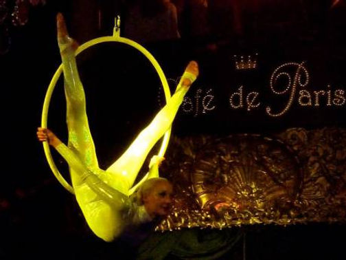 Katie Hardwick aerial hoop performance in white catsuit at cafe de paris london