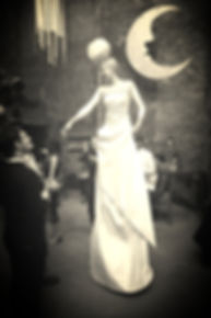 Katie Hardwick elegant stilt walker lady in white