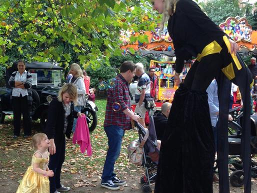 Queen Bee on stilts at Surbiton Festival