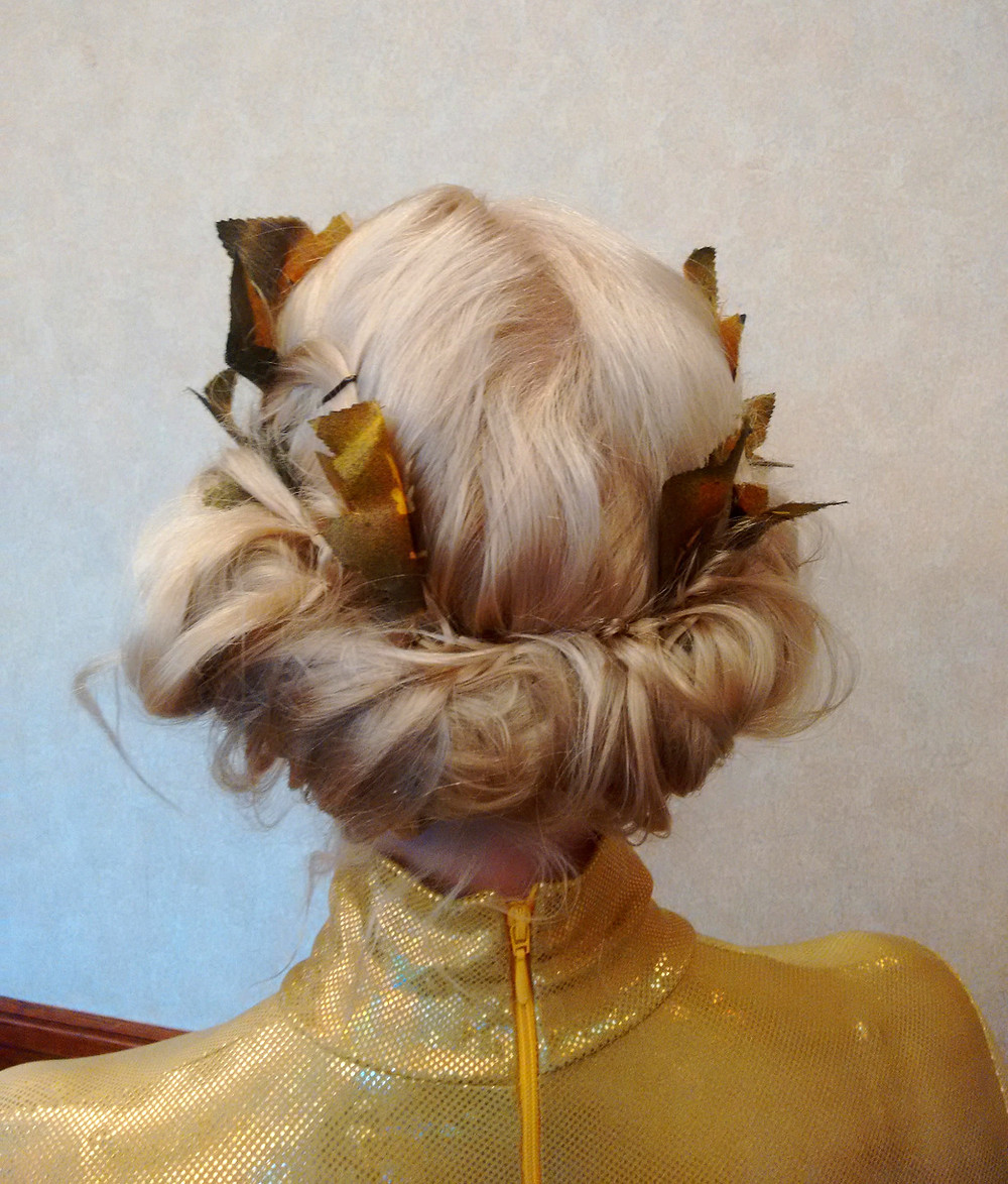 Roman themed hair style with leaves
