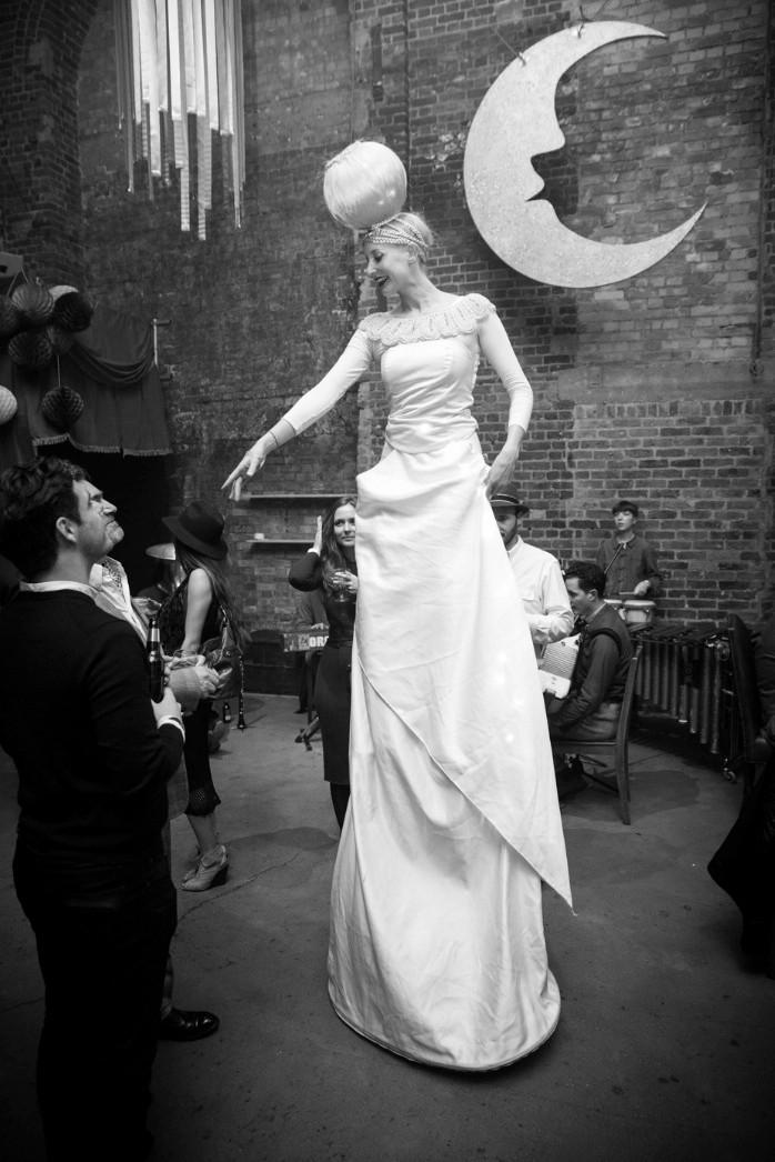 Elegant Lady in White Stilt Walker London