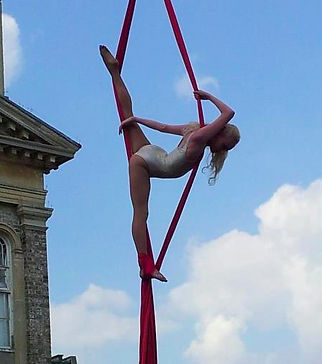 Katie Hardwick performing silks outdoors