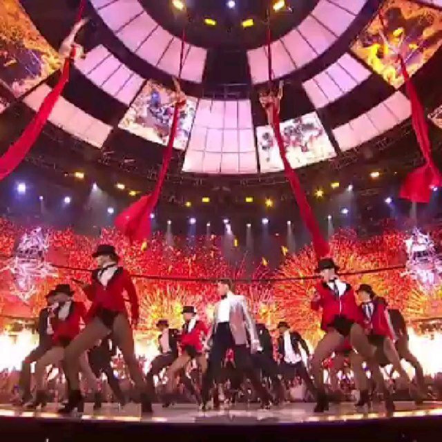 Silks aerialists with Hugh Jackman at the Brits Grestest Show opening