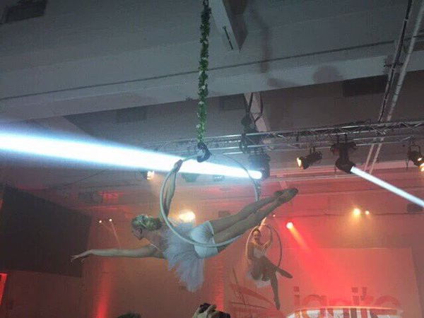 Aerial hoop as ballerinas in white