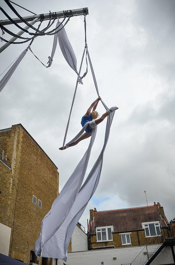 Circus Suburbia aerial silks performer Katie Hardwick at Kingston Riverside Walk aerial rig