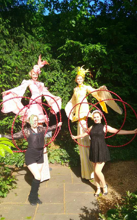 Circus Suburbia garden party stilt walkers and hula hoopers