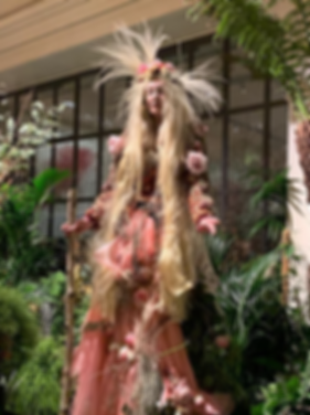 Katie Hardwick stilt walking as Mother Earth for Petersham Nurseries