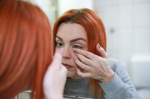 woman wearing contact lenses