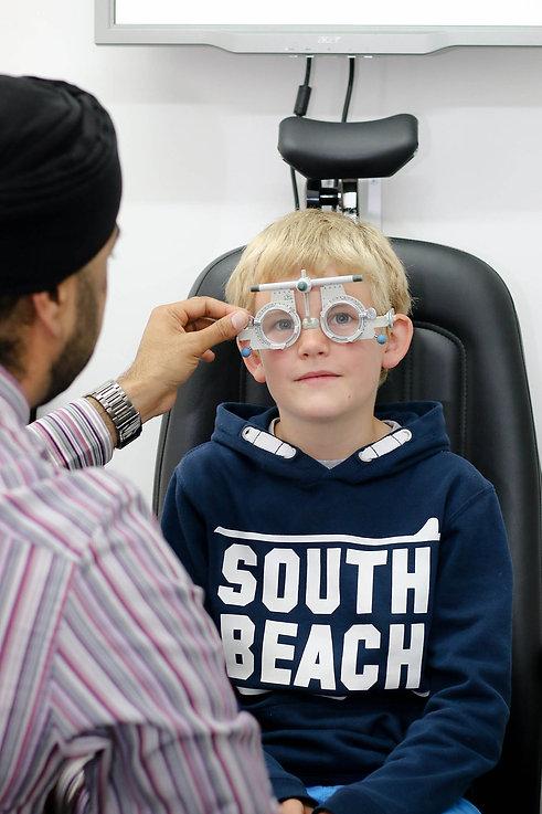 optician testing child's eyes