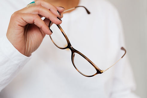 woman holding spectacles for repair