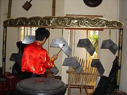 Bha Nha playing stone chimes, Hanoi. Pho