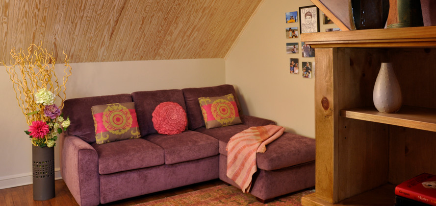 Attic with purple sofa