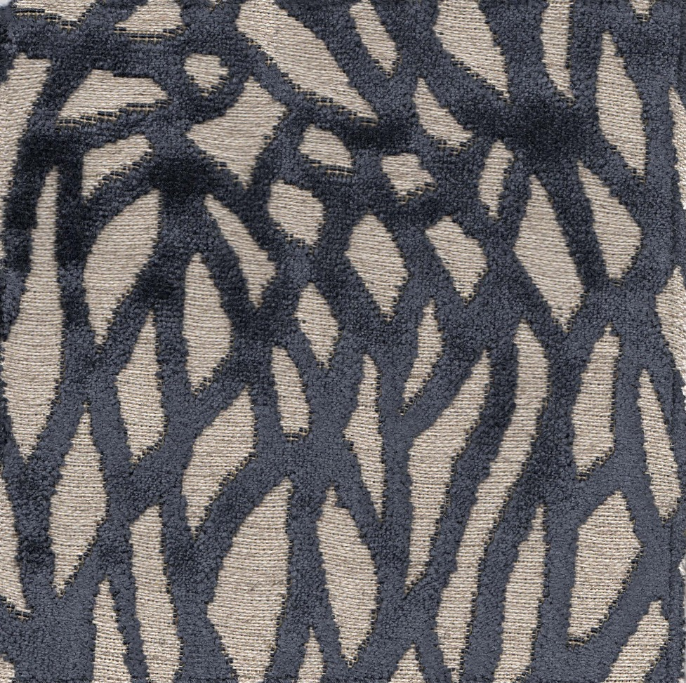 The random contemporary patterning on the chair fabric again suggests the ornate movement of the antique oriental rug.