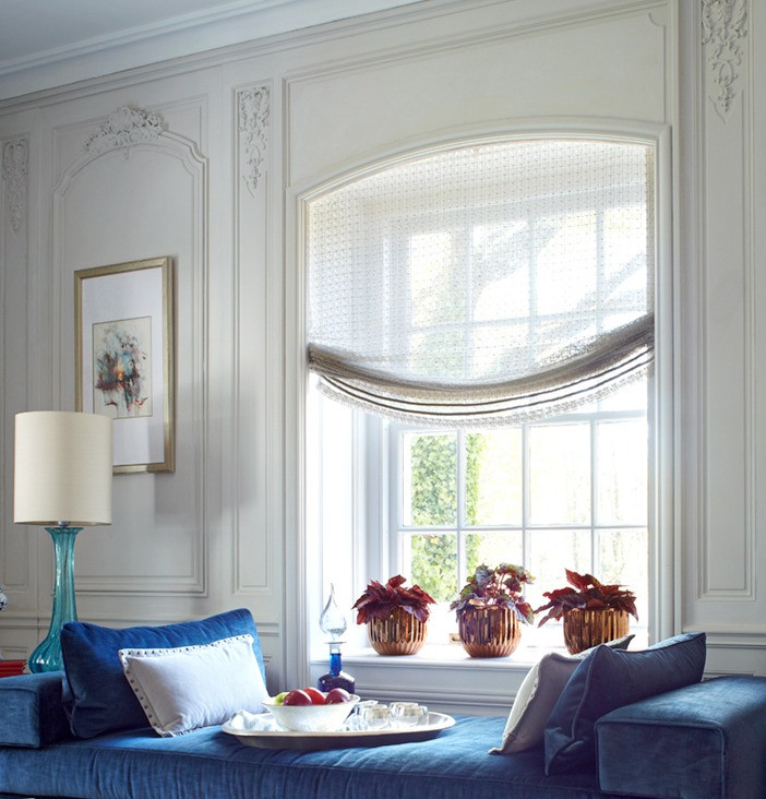 The decorative architectural window surround was designed with window drapery in mind.