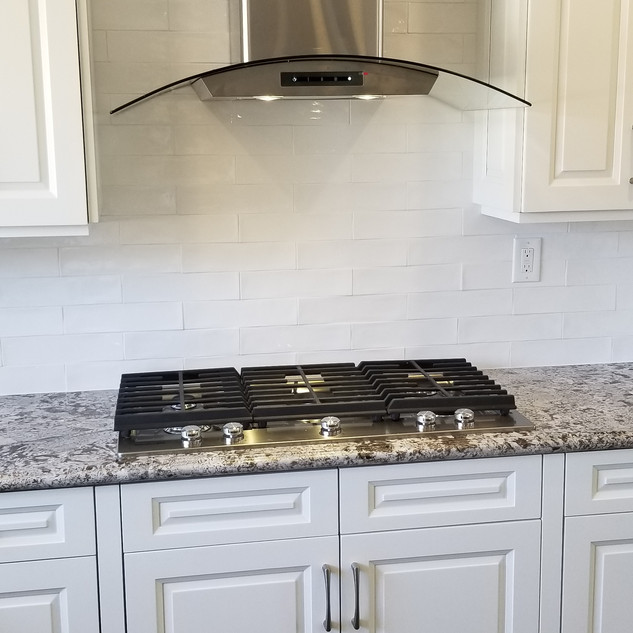 New Hood Range and Counter Top and Backsplash