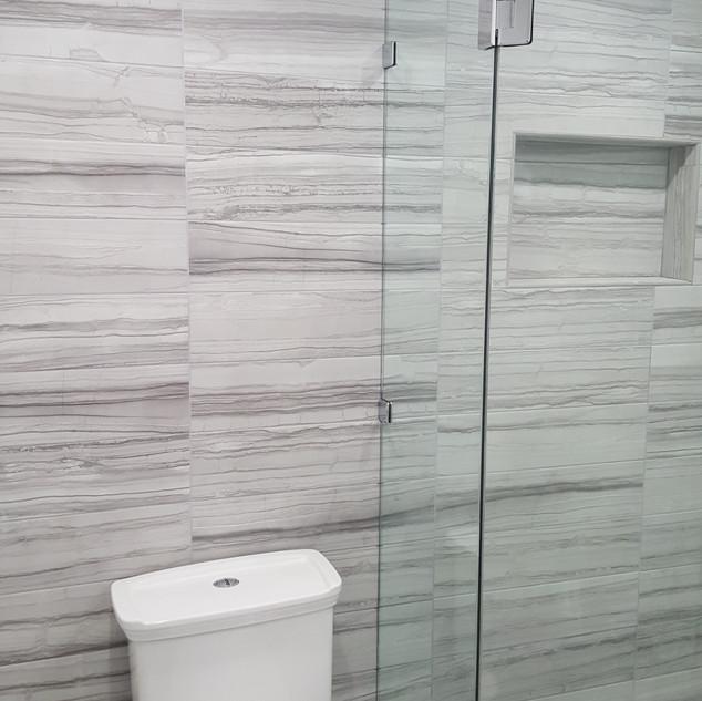 Floor to Ceiling Tile Bathroom