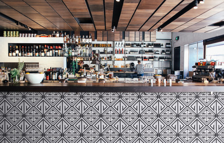 Thalia on the bar below the countertop.j