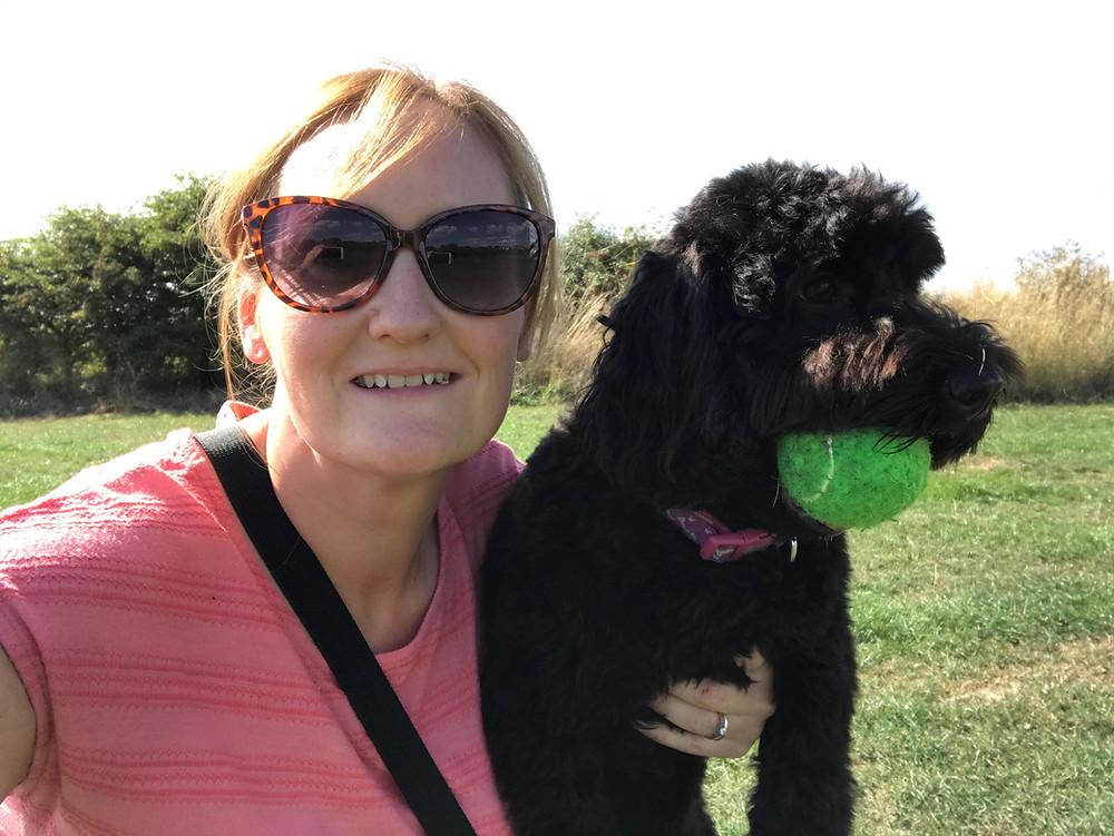 Helen holding her Cockapoo Maisie