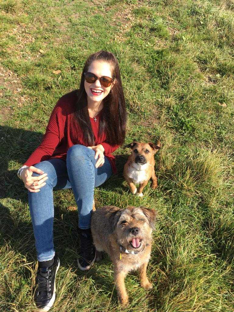 Gemma sat with two dogs