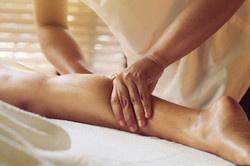 Woman laying down on a spa massage bed..