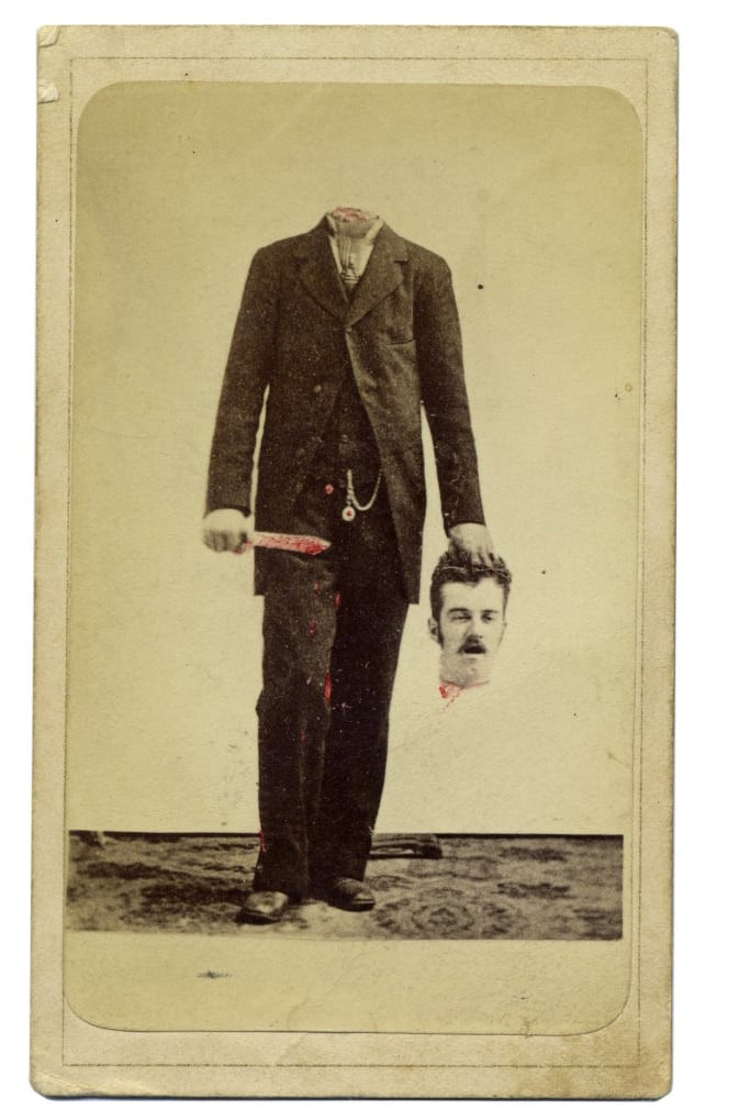 black and white photo of headless man in suit holding his head in one hand and a knife in the other