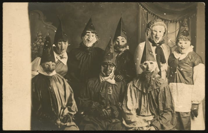 very creepy grainy black and white photo of people in halloween costumes