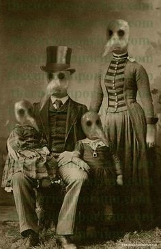 black and white photo of family Husband with children in arms wife standing behind all wearing plague masks