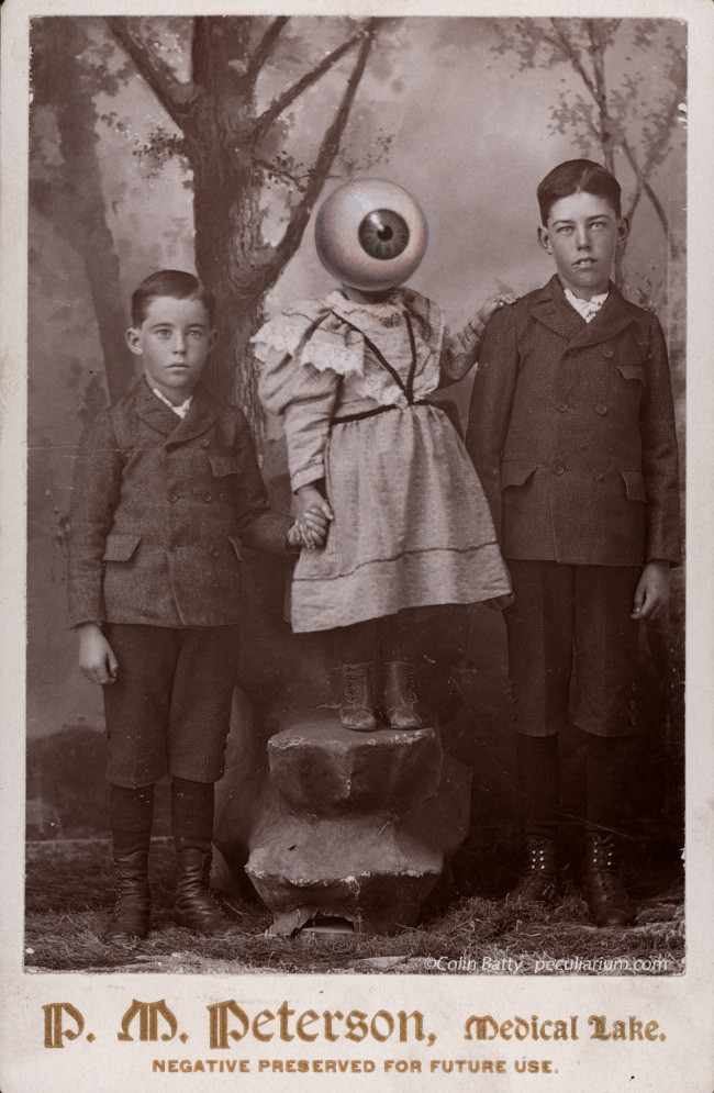 black and white photo three children two boys and a girl in between them the boys are normal the girl has one huge eye instead of a head