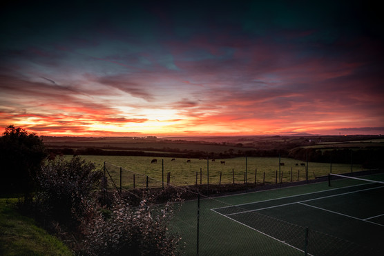 Tennis court at Tregaddra Farm