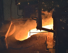 Molten metal being poured from furnace