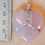 Thumbnail: Sterling Silver Wrapped Rose Quartz Crystal Heart Pendant with Celtic Knot Twist