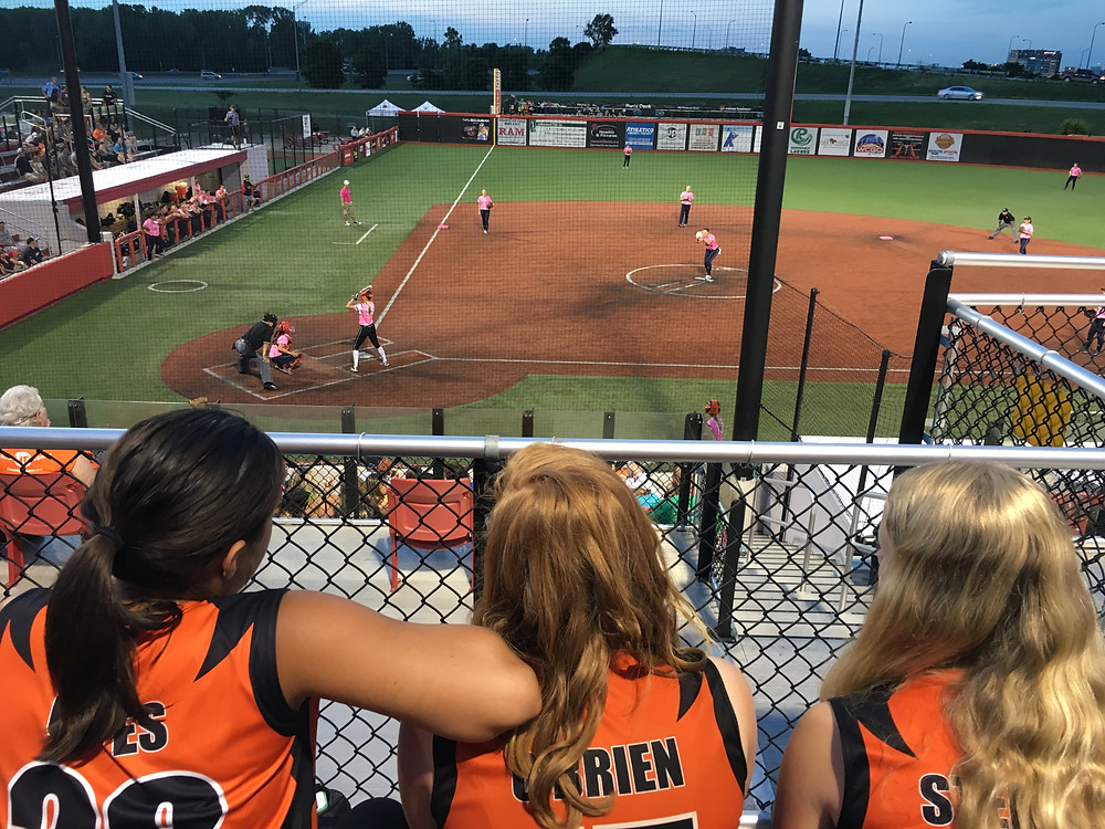 lil m and her team enjoying a Chicago Bandits game