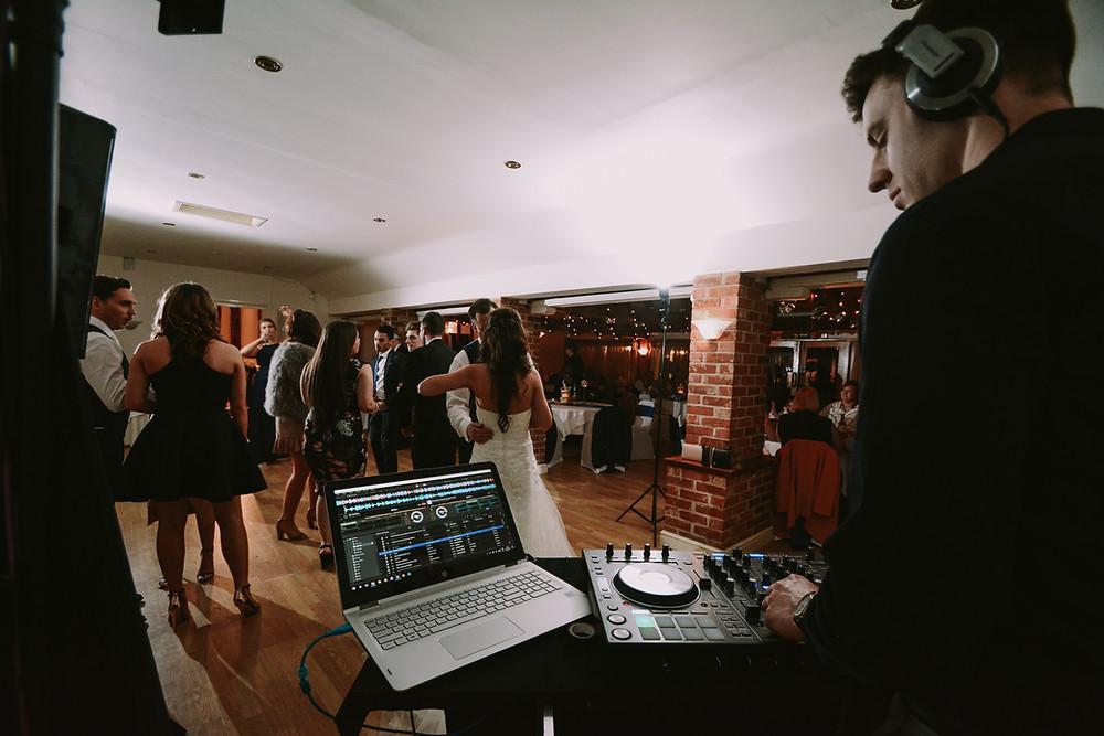 Disc Jockey (DJ) playing some wedding music.