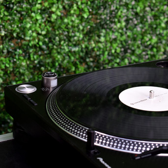 Turntable with our Flower Wall + Neon Sign